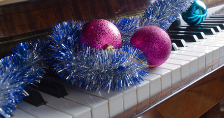 Christmas decorations lie on a piano