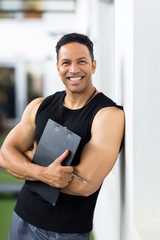 male trainer with clipboard