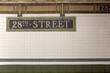 Leinwandbild Motiv New York City Station subway 28th Street  sign on tile wall.