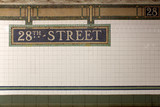 New York City Station subway 28th Street  sign on tile wall.