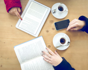 Women with phone,ebook and book