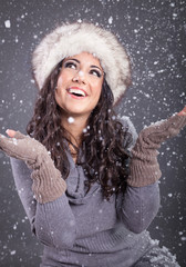 Beauty portrait of young attractive woman over snowy Christmas