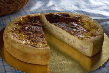 Quiche cut in half on a picnic