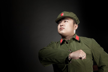 Chinese soldier. Gray background