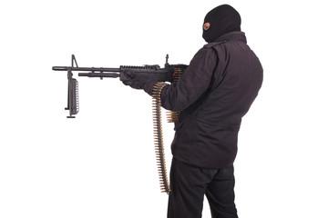 rebel in black uniforms with machine gun