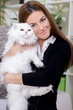 young woman holding a Persian cat