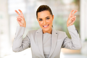 young career woman showing quote hand sign