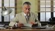 Confident vintage businessman working at desk