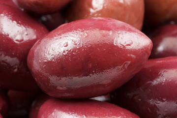 Extreme close-up of one wet purple olive