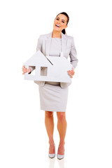 businesswoman holding paper house