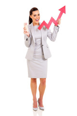 businesswoman holding money and stock arrow