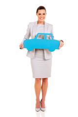 woman presenting paper car symbol