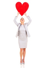 young business woman holding heart shape