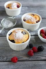 three cupcakes with berries