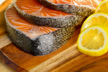Delicious  portion of fresh salmon fillet with lemon