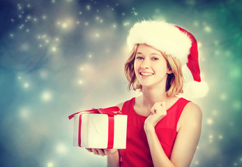 Happy young woman with Santa hat