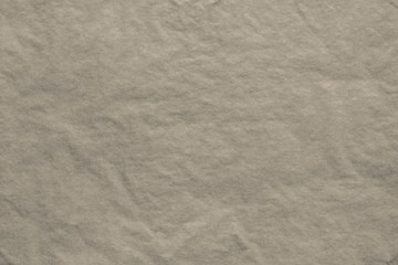 texture of thin crumpled dark-beige paper