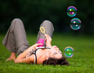Women Blowing Bubbles in the park
