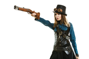 steampunk woman holding a gun isolated.