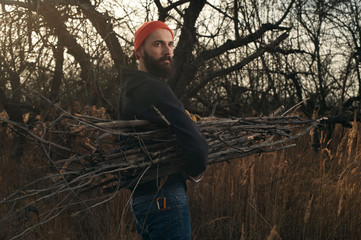 bearded lumberjack cleans up in apple orchard