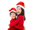 happy little Girls with christmas hat and Giving  Another Hug