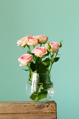 bouquet of pink roses in a glass vase