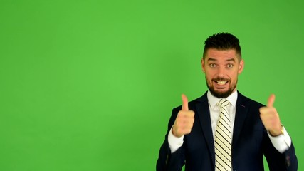 business man shows thumbs on agreement - green screen - studio