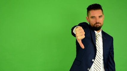 business man shows thumb on disagreement - green screen - studio