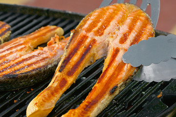 Portion of fresh salmon fillet on a grill