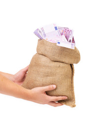 Man hands holding money bag