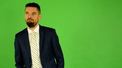 business man walks and smiles - green screen - studio