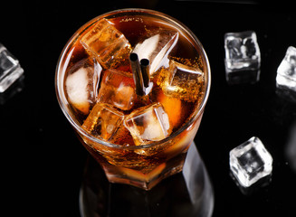 Full glass of cola with ice cubes