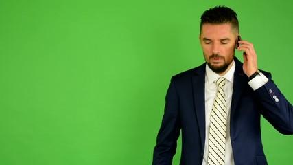 business man phone (serious face) - green screen - studio