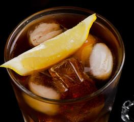 glass of cola with lemon