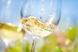 Fototapety Pouring white wine in a glass