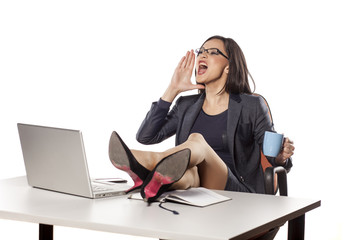 angry businesswoman with legs on the table command to others
