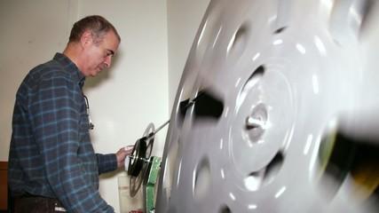 Film Technician Rewinding 35mm Film