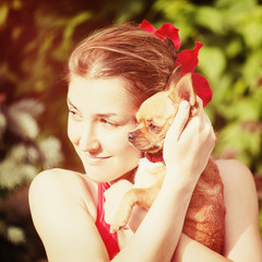 Cute Girl and Her Chihuahua Dog on Nature Background.