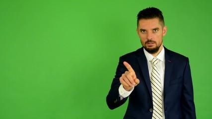 business man disagrees - green screen - studio