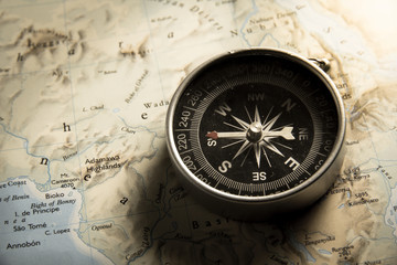 Vintage filtered of compass with map.