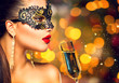 Sexy model woman wearing carnival mask with glass of champagne