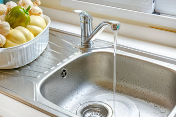 Kitchen faucet with a flowing water