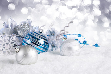 blue christmas balls with decorations on snow