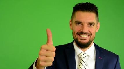 business man shows thumb on agreement - green screen - closeup