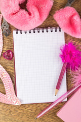 open notebook on a pink girly background