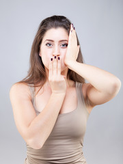 Beautiful young caucasian woman doing face yoga pose