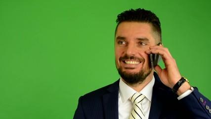 business man phone and smiles - green screen - closeup