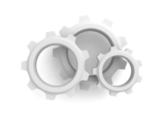 three connected cogwheel gears on white background