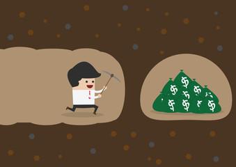 Businessman digging to find money