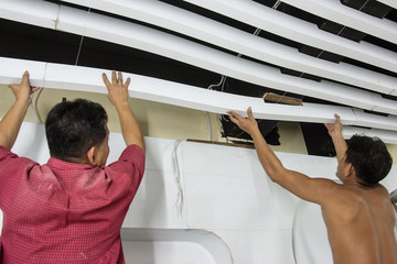 construction workers  make the ceiling withe lath  in constructi